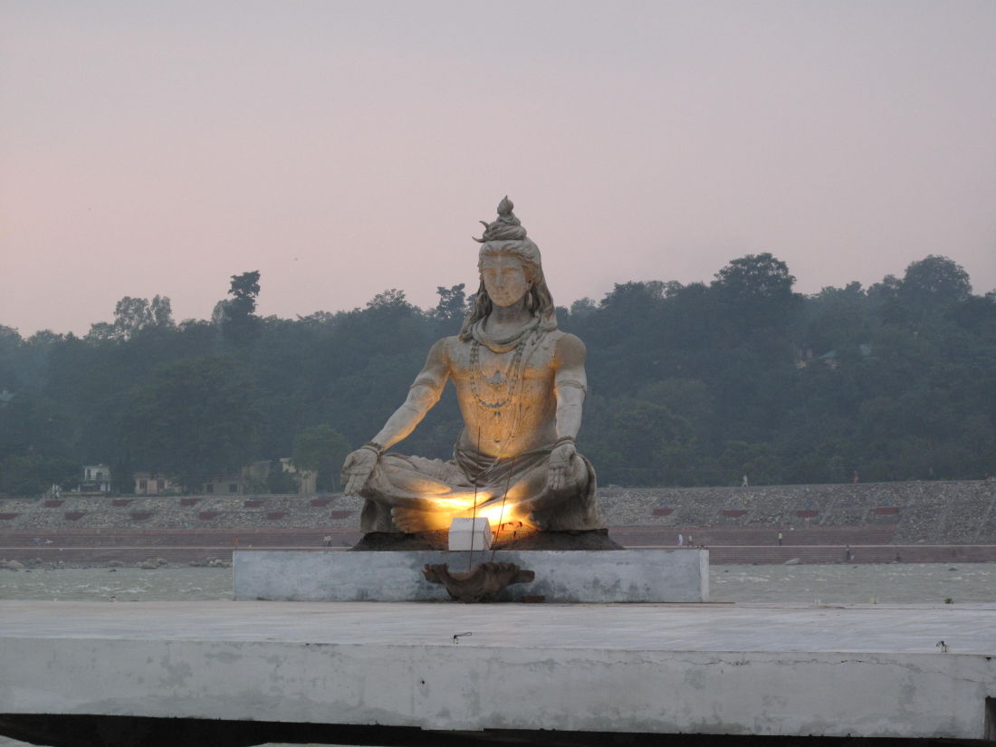 Krishna statue on the banks of the river Ganges