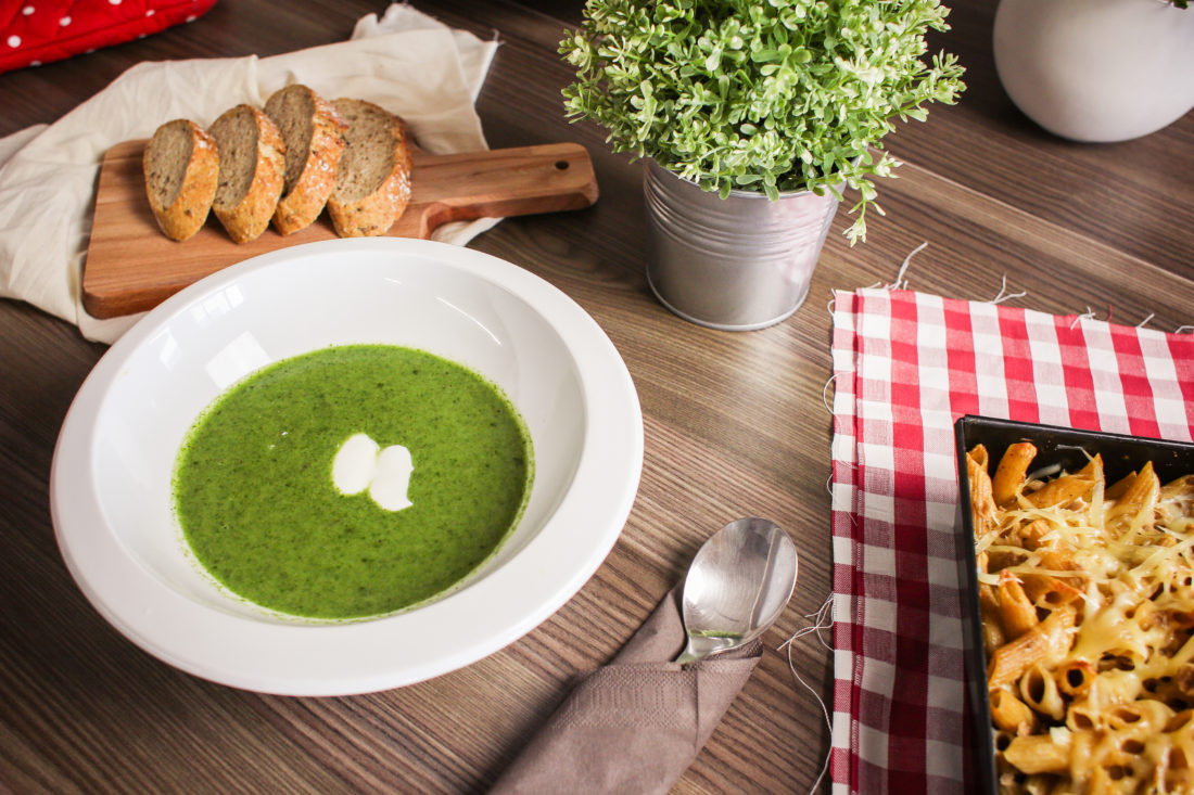 Bowl of spinach soup with bread