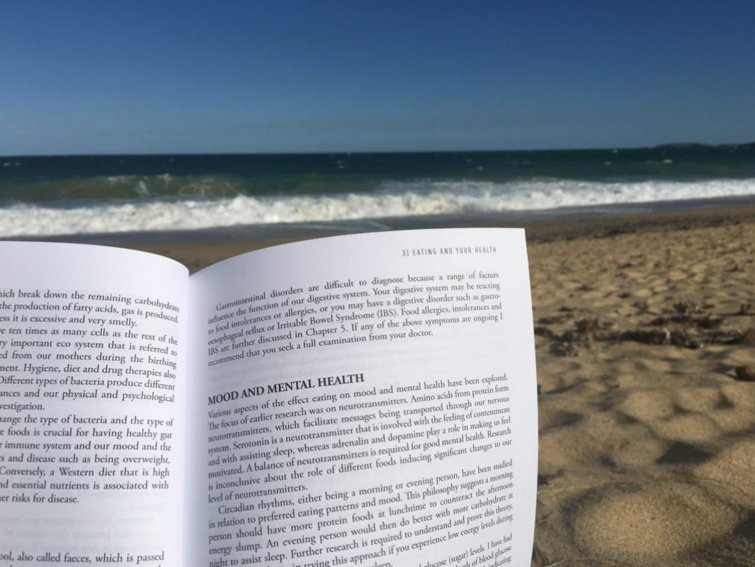Reading Eating for You at the beach