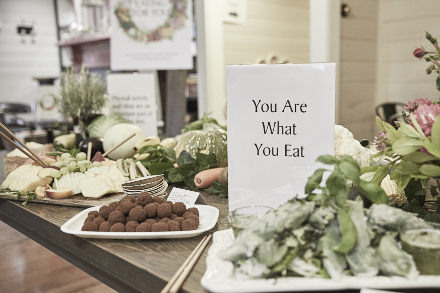 Table of nutritious snack options with sign 'you are what you eat'