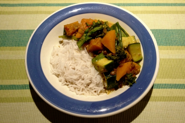 Bowl of mixed vegetable lentil and pumpkin curry with basmati rice