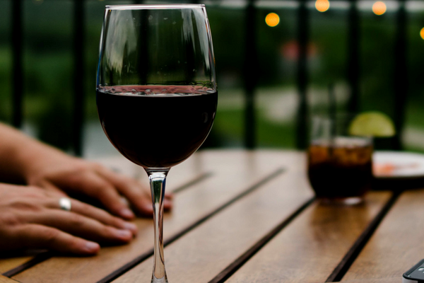 Glass red wine on outdoor dining table