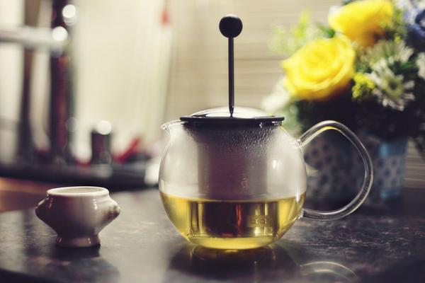 Pot of herbal tissane on a kitchen bench