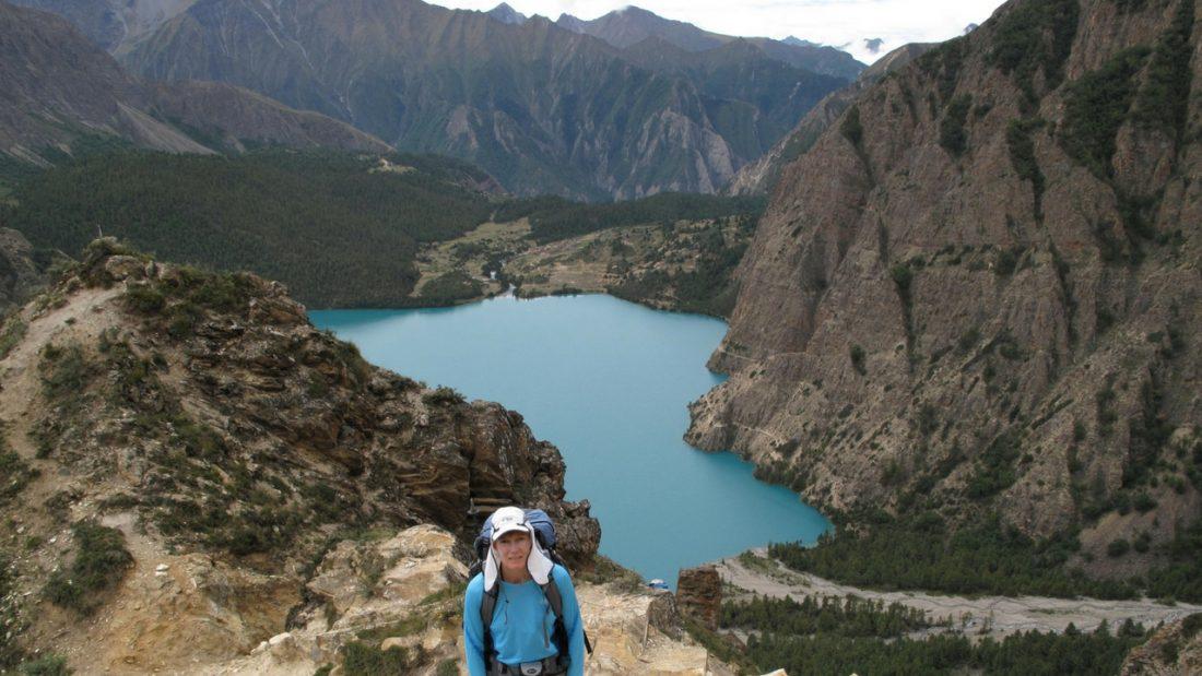 Sallyanne standing above Phoksundo Lake Dolpo Trek Nepal