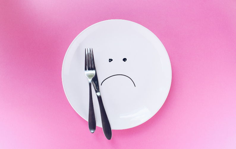 Empty plate with sad face