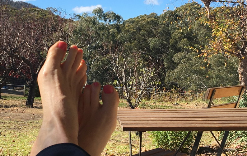 Feet up resting in the garden during a home health retreat