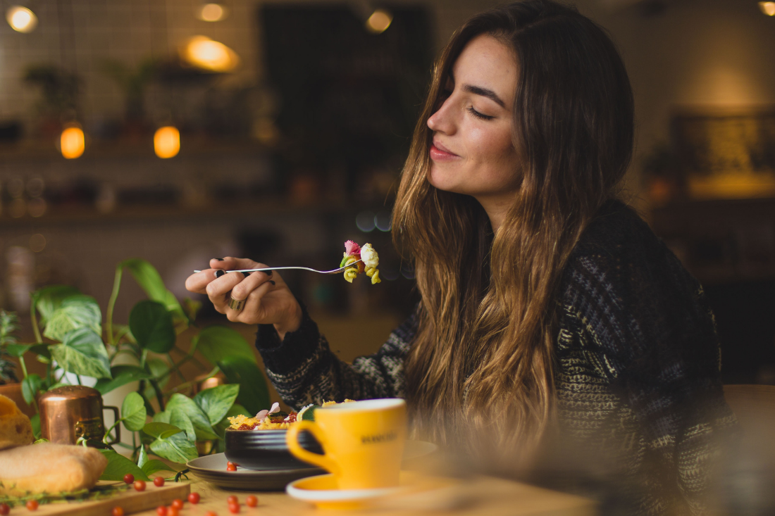 Woman enjoying her meal mindfully