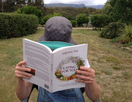 Reading Eating for You in a country garden