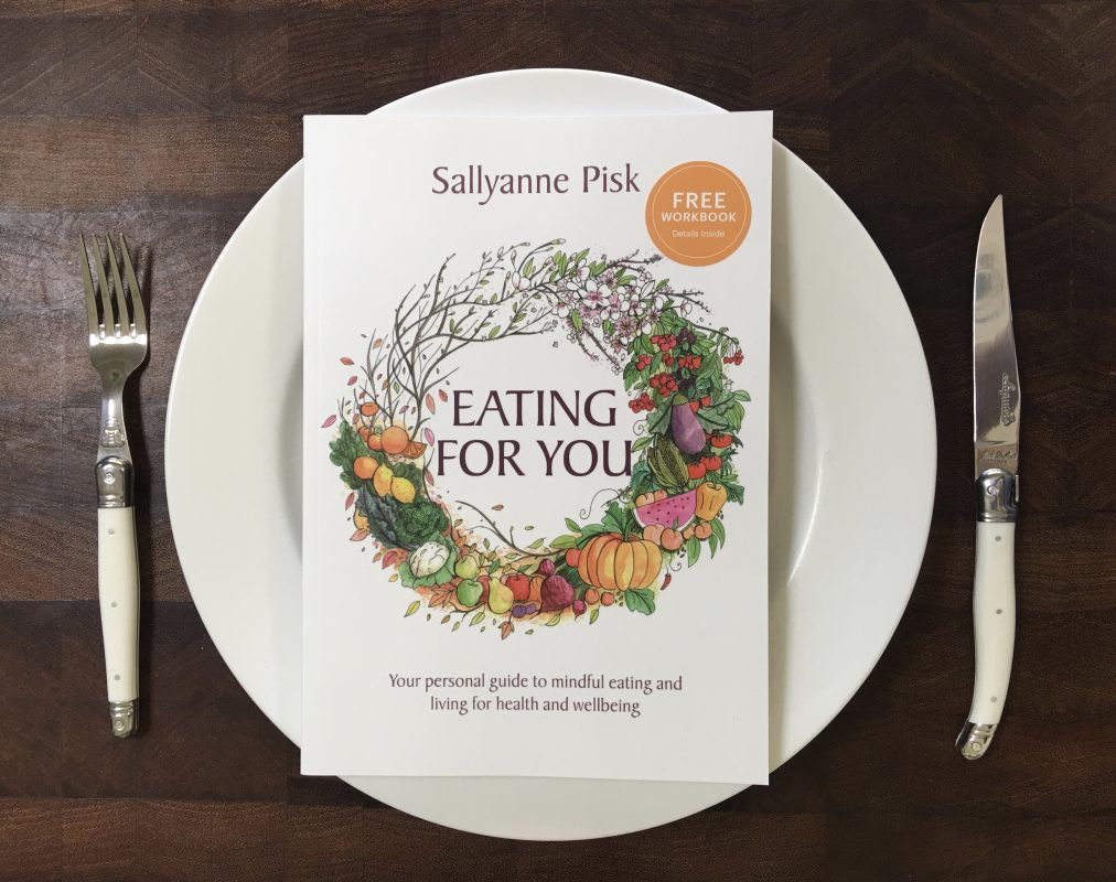 Eating for You book on a dinner plate with a fork and knife.