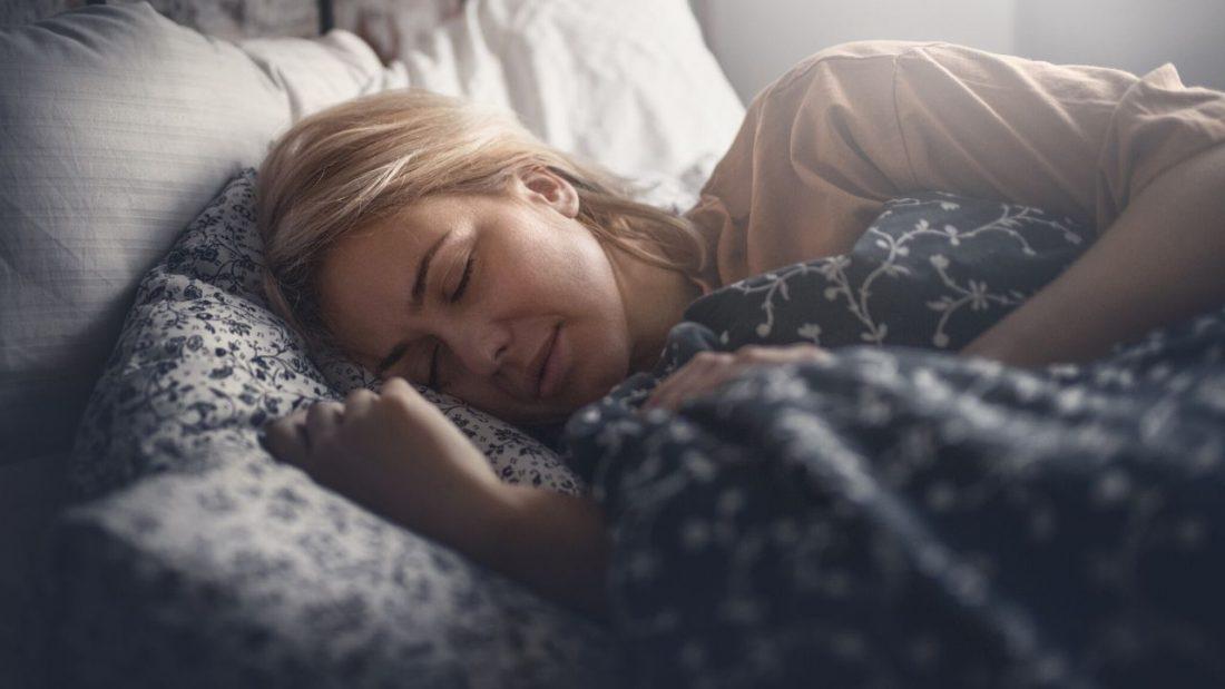 Woman sleeping. Sleep is an important part of diata.
