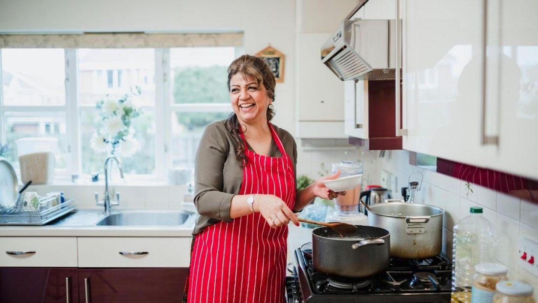 Woman enjoying cooking in her kitchen