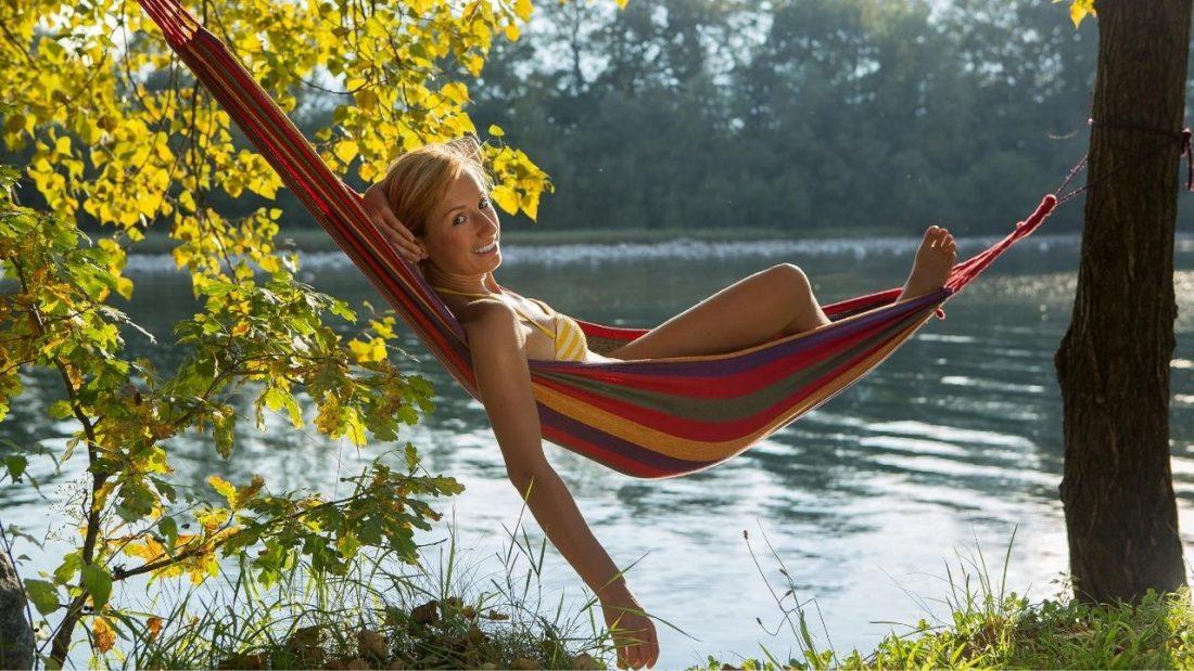 woman laying in hammock
