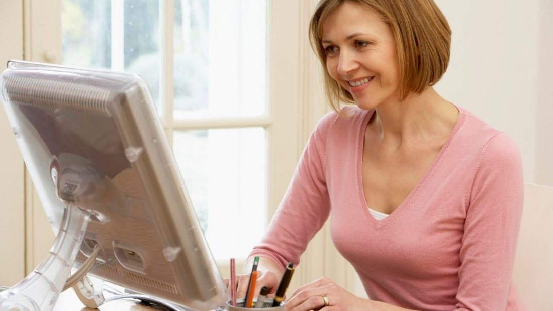 Woman mindfully working on her computer