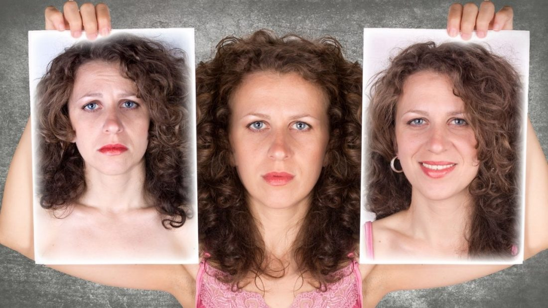 Woman holding images of herself sad and happy
