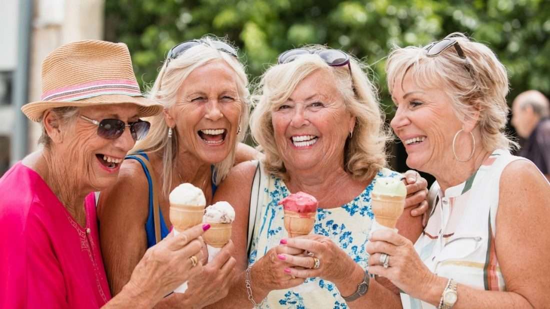 Four ladies laughing and holding icecream cones