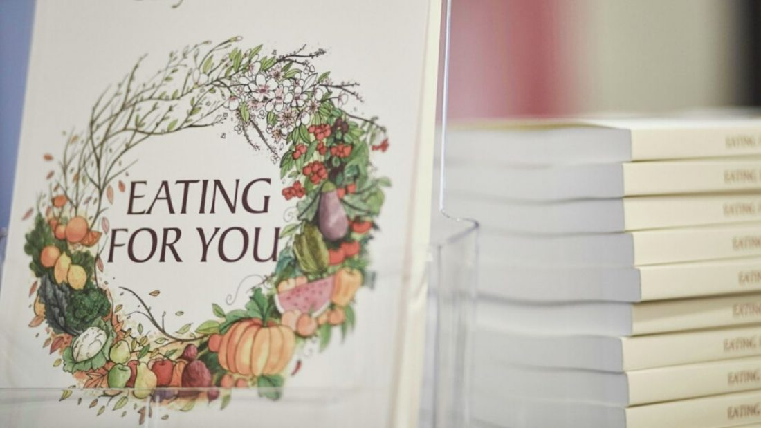 A display of the eating for you book and harvest wreath front cover