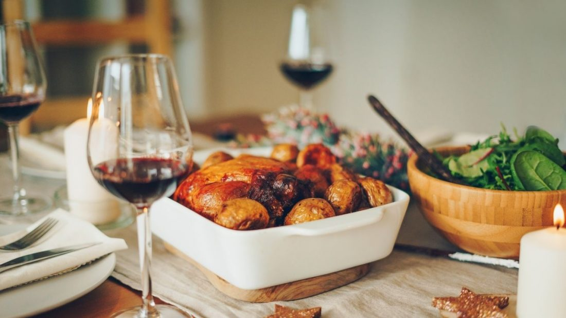 A simple Christmas lunch with small roast and bowls of salads