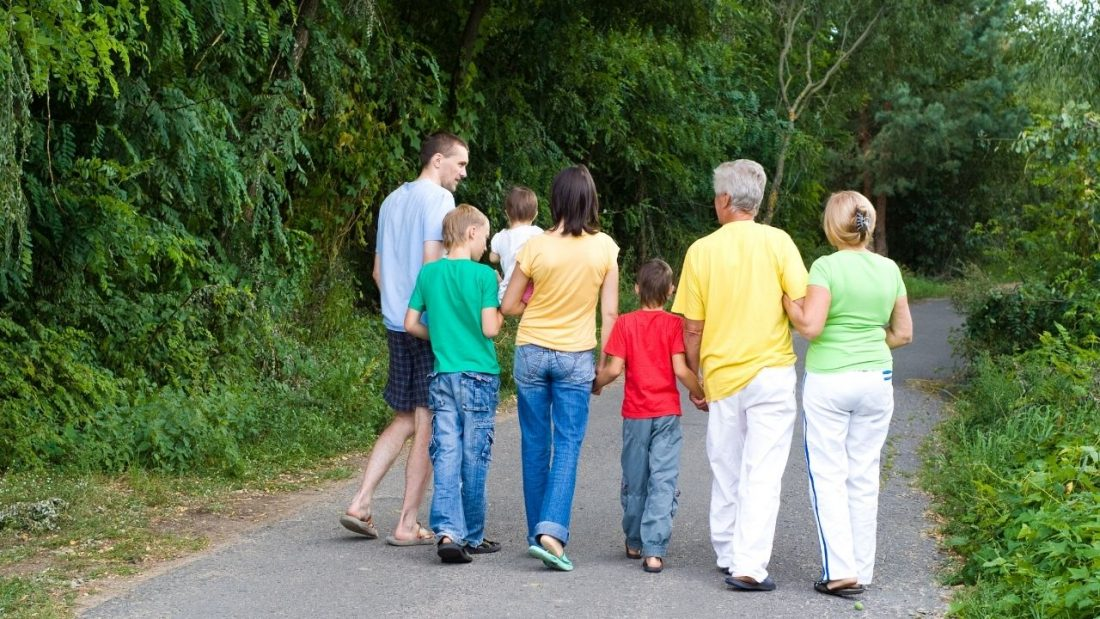 Family walking along a country road