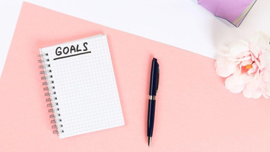goals notebook next to a pen